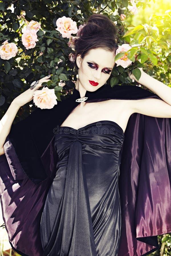 Beautiful woman wearing silk dress stock photo