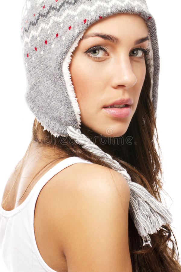 Beautiful woman wearing winter cap looking over he stock photos