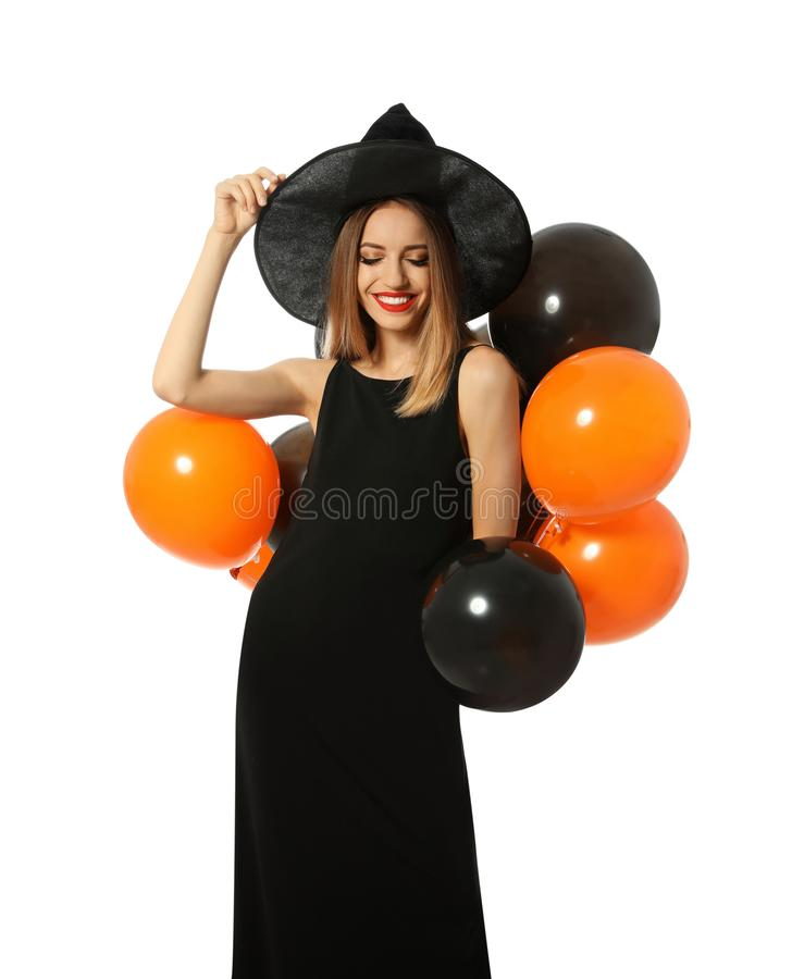 Beautiful woman wearing witch costume with balloons for Halloween party royalty free stock photo