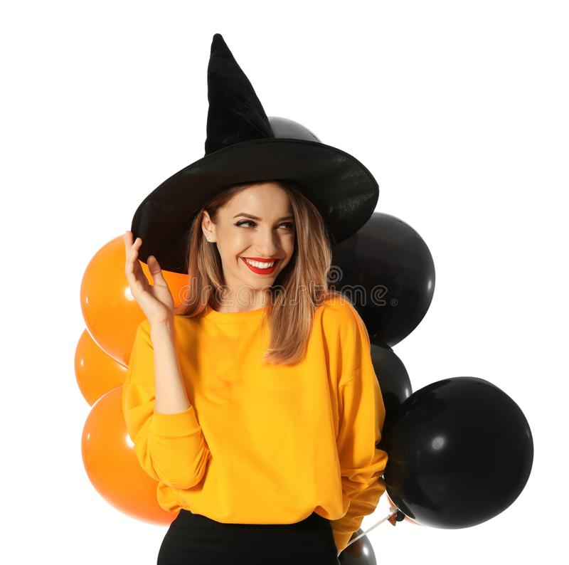 Beautiful woman wearing witch costume with balloons for Halloween party on white royalty free stock photo