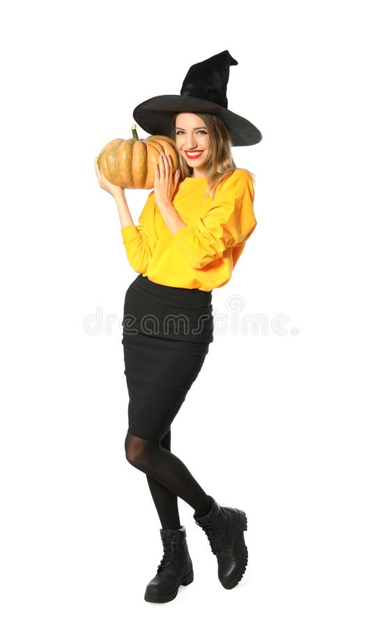 Beautiful woman wearing witch costume with pumpkin for Halloween party stock photography