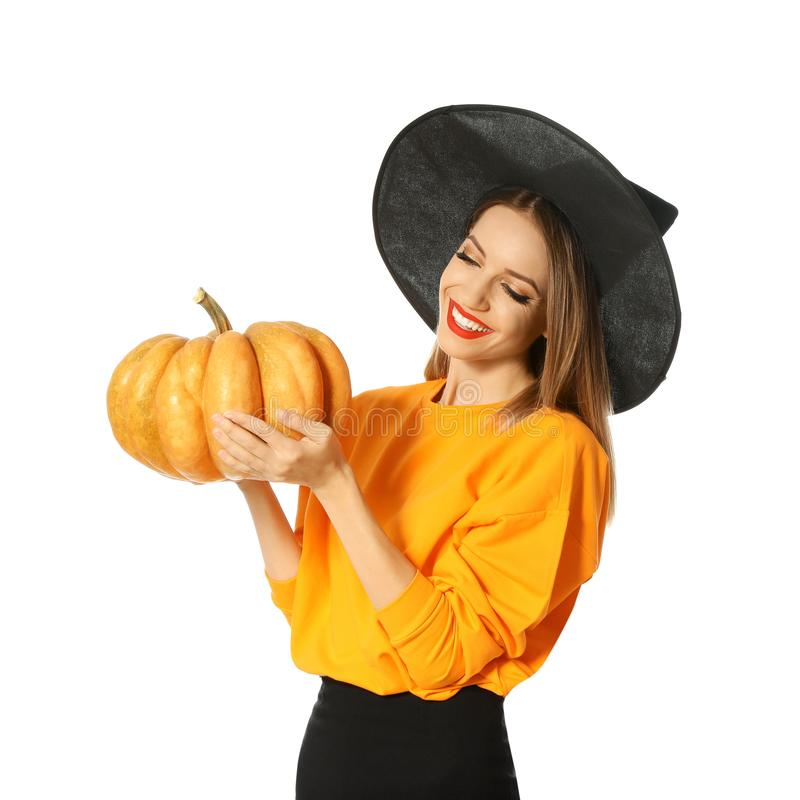 Beautiful woman wearing witch costume with pumpkin for Halloween party royalty free stock photos