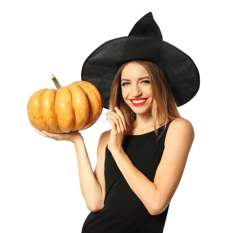Beautiful woman wearing witch costume with pumpkin for Halloween party on white stock photo