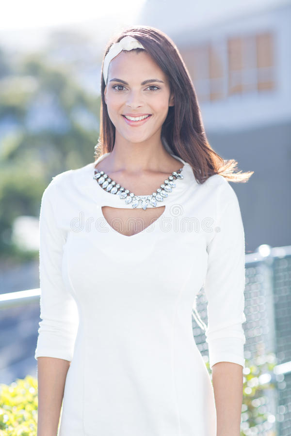 Beautiful woman well dressed smiling at camera stock photo