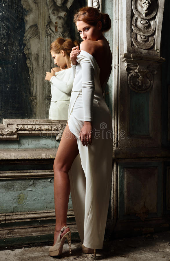 Beautiful Woman In White Dress With Naked Back Obsolete