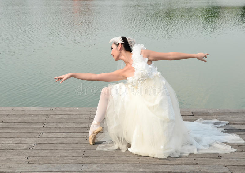 Beautiful woman in white gown of the bride dance royalty free stock photo