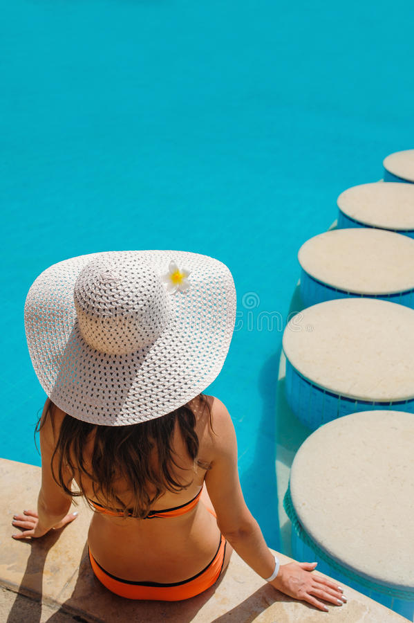 Beautiful woman in a white hat sitting stock images