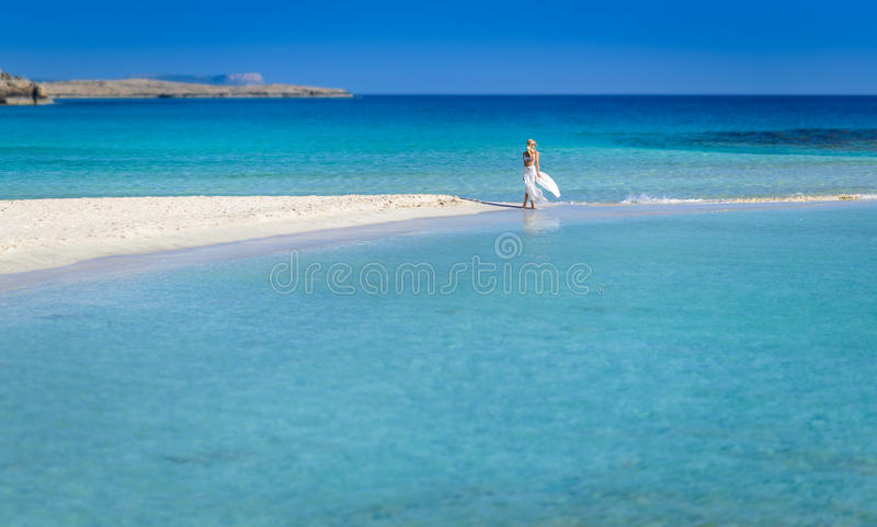 Beautiful woman in white,Nissi beach,ayia napa cyprus royalty free stock images