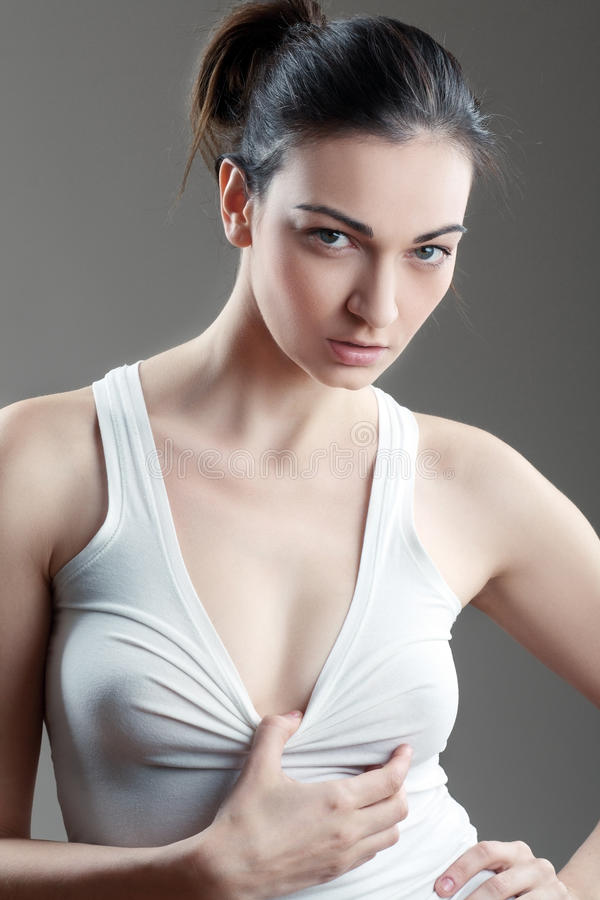 Beautiful woman in white top stock photography