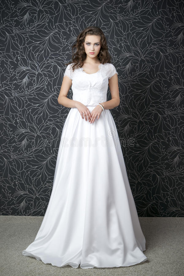 Beautiful woman in white wedding dress royalty free stock photo