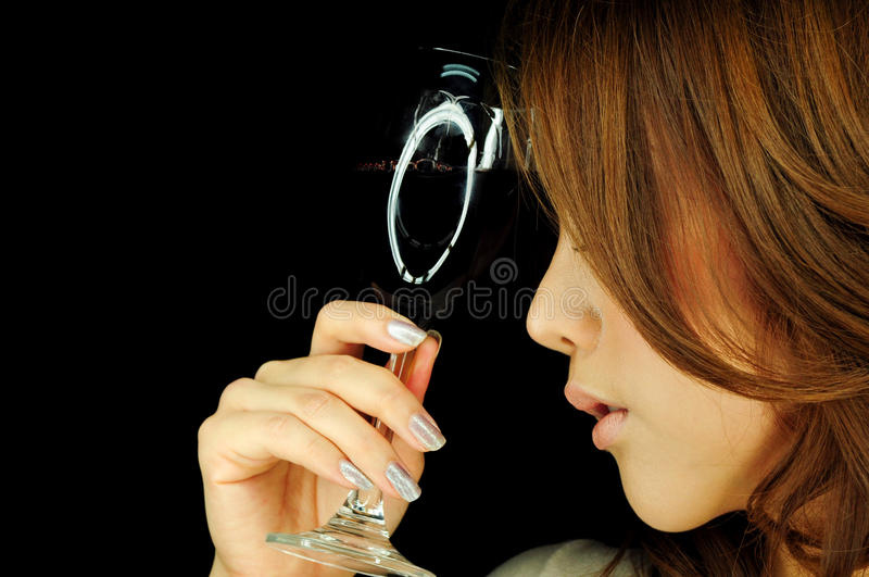 Beautiful woman with wine glass royalty free stock photography