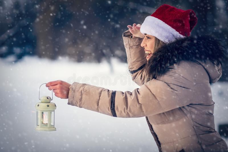Woman on winter forest with lantern –winter holidays, Christmas and people concept. Beautiful woman on winter forest with lantern –winter holidays stock photo