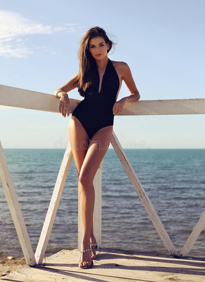 Free Beautiful Woman With Dark Hair In Swimsuit Relaxing At Beac Stock Photo - 95751860