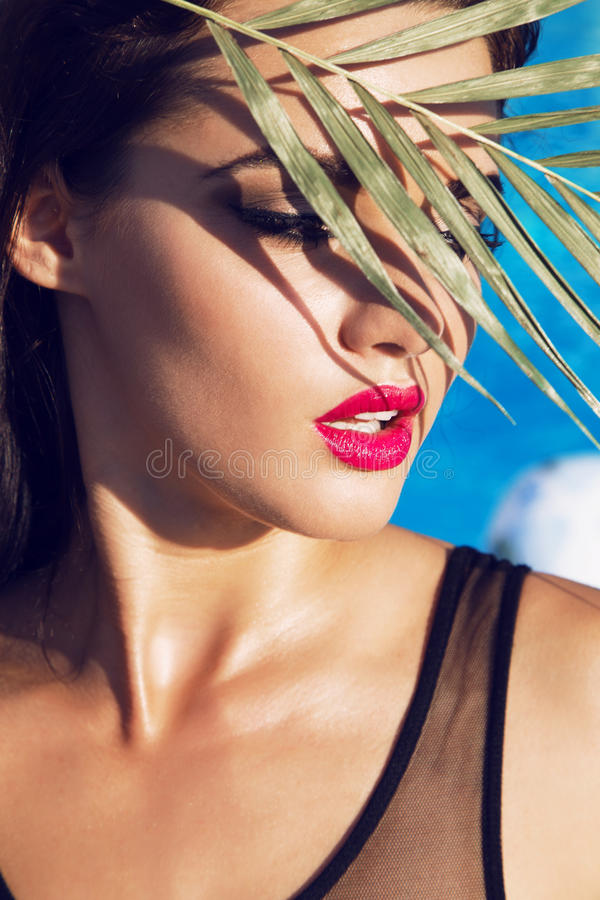 Free Beautiful Woman With Dark Hair Relaxing Beside Swimming Pool Royalty Free Stock Image - 61318176