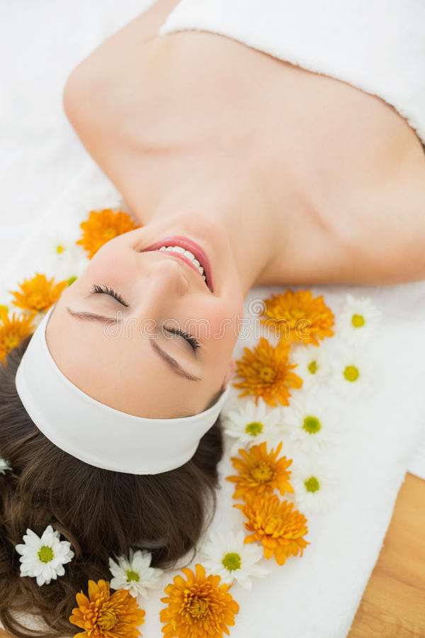 Free Beautiful Woman With Eyes Closed And Flowers In Beauty Salon Royalty Free Stock Image - 35027926