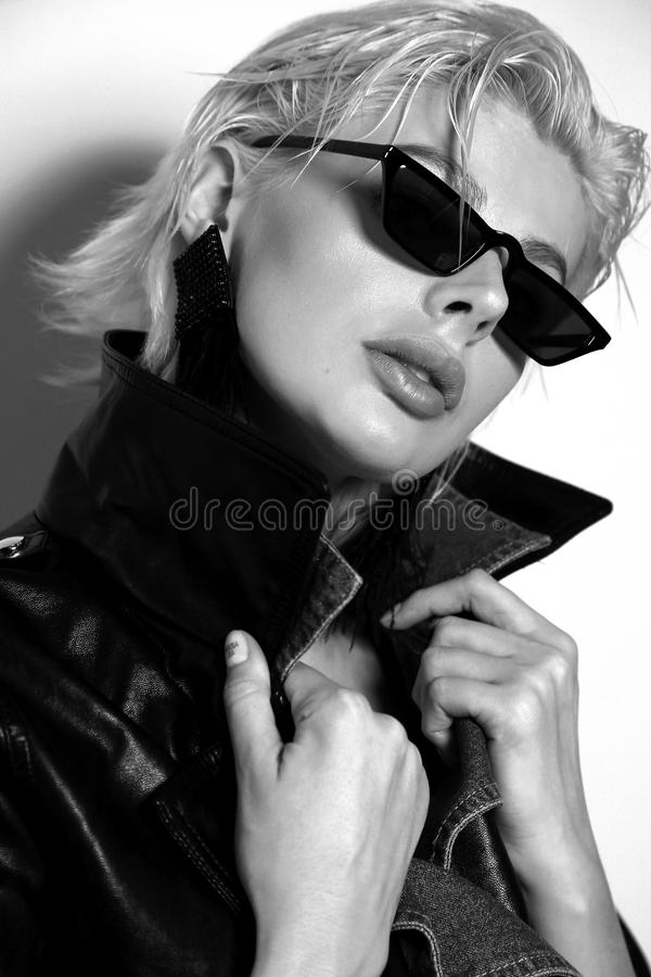Free Beautiful Woman With Short Blond Hair In Elegant Clothes With Fashion Sunglasses Stock Image - 144917241