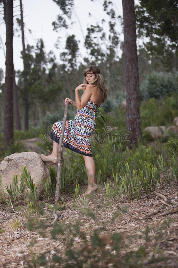 Beautiful woman in the woods royalty free stock photos