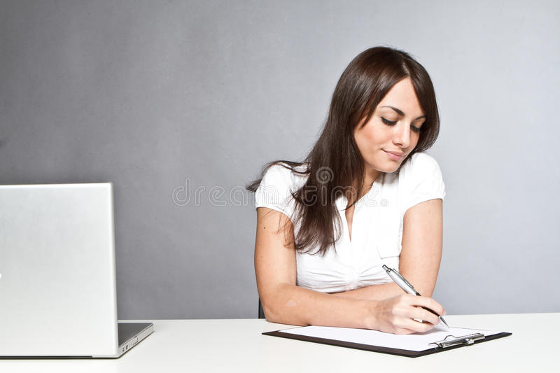 Beautiful woman working stock images