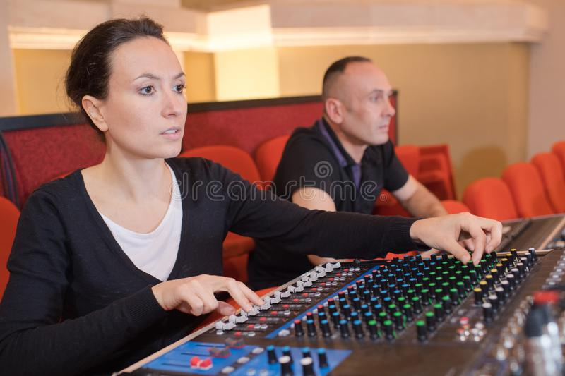 Beautiful woman working as radio dj live in studio. Beautiful women working as radio dj live in studio female royalty free stock photography