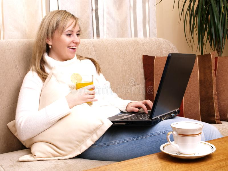 Beautiful woman working on her laptop. royalty free stock photo