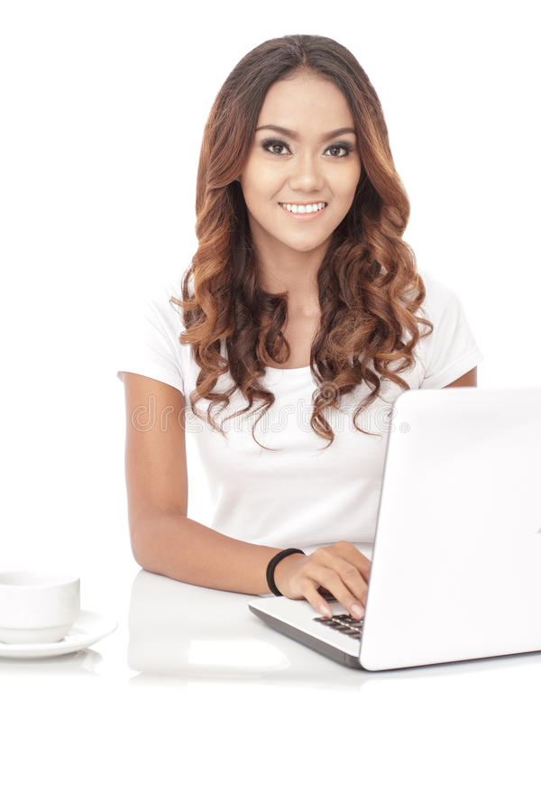 Beautiful woman working on her laptop. Portrait of beautiful woman working on her laptop on white background stock photos