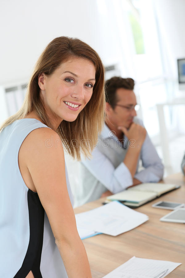 Beautiful woman working at office stock photography