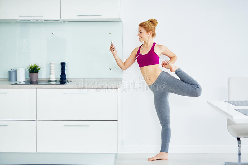 Beautiful Woman Working Out at Home stock image
