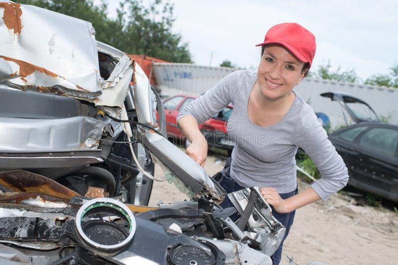 Beautiful woman working in scrap yard royalty free stock photos