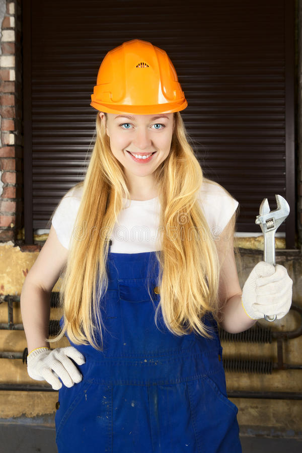 Beautiful Woman With Wrench royalty free stock photos