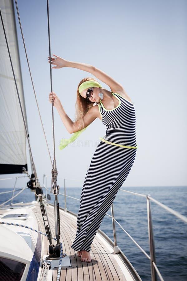 Beautiful woman on yacht stock photos
