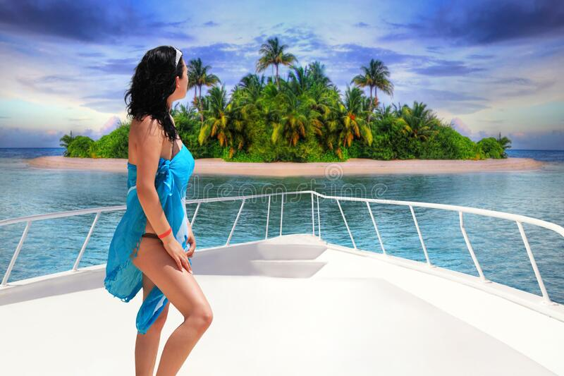 Beautiful woman on the yacht cruise at the tropical island, Maldives royalty free stock images