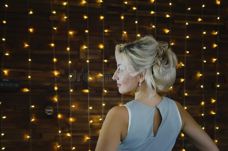 Beautiful woman 40 years old with blond hair, profile royalty free stock photos