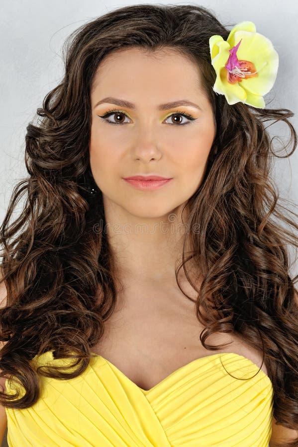 Beautiful Woman In A Yellow Dress Stock Image