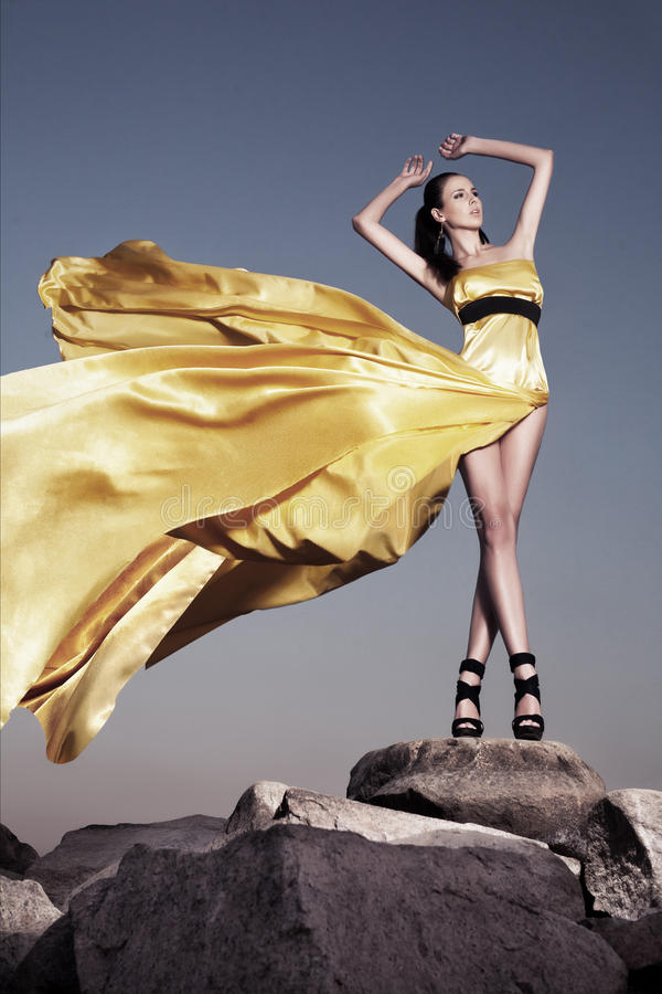 Download Beautiful Woman In Yellow Evening Dress Stock Photo - Image: 22188224