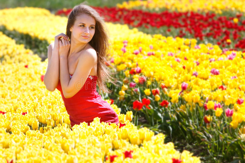 Download Beautiful Woman In Yellow Tulips Stock Photo - Image of jolly, girl: 14227946