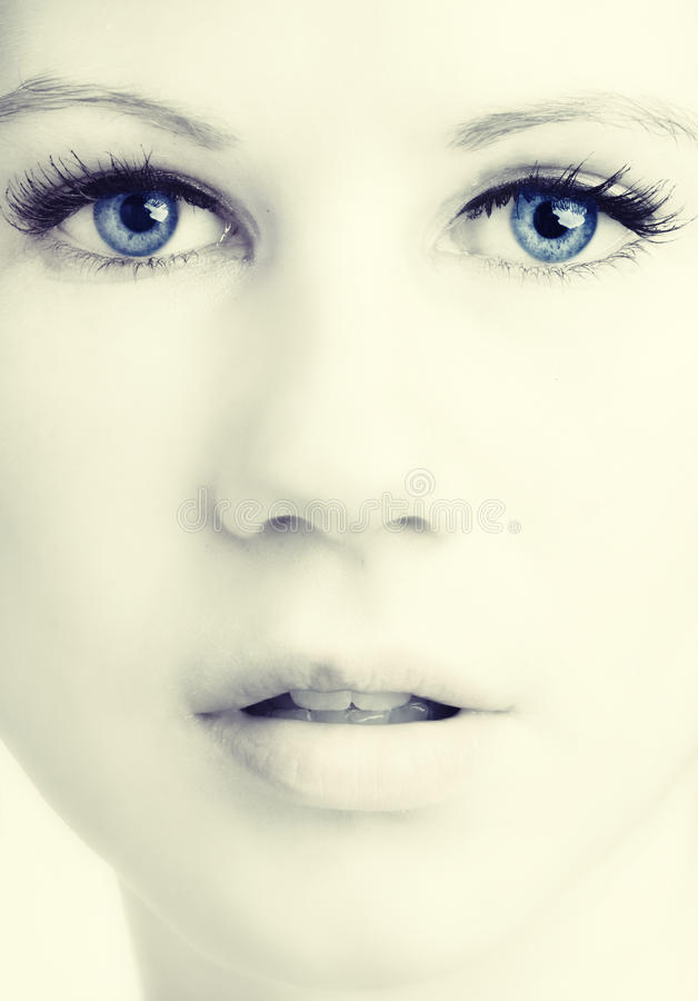 Beautiful womans face with blue eyes stock photo
