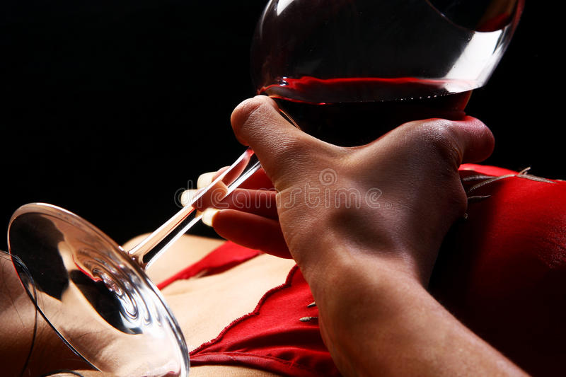 Beautiful womans hand with glass of wine stock photos