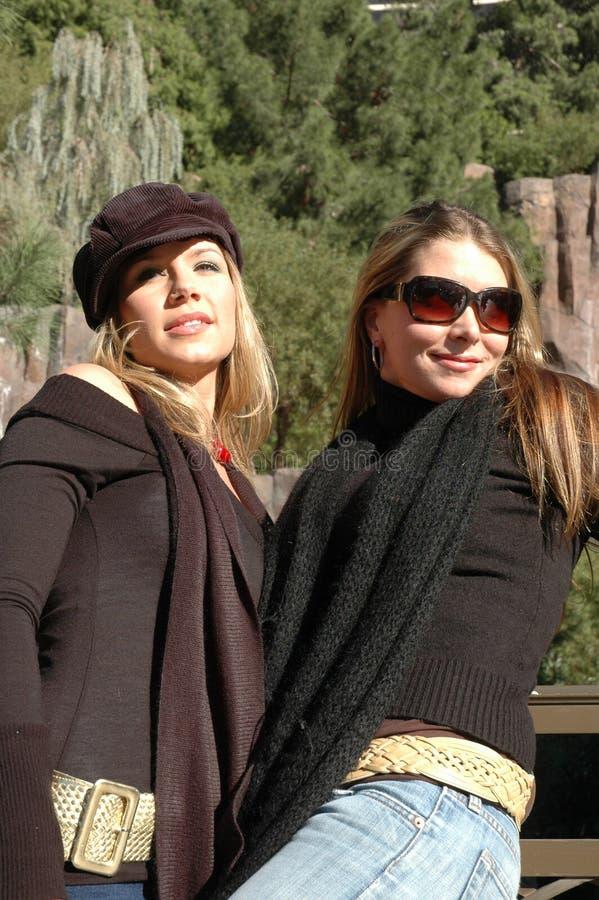 Beautiful Women. Women standing in front of a waterfall. Beautiful fashion women royalty free stock image