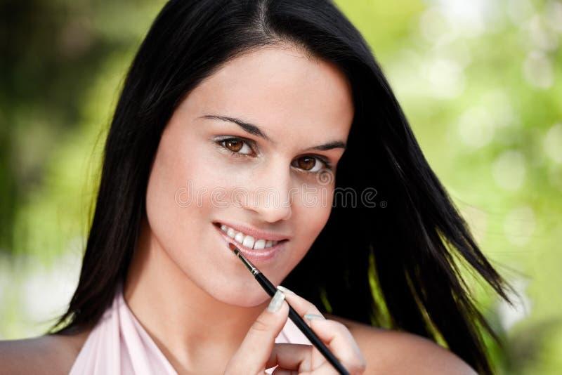 Download Beautiful Women Applying Lipstick Stock Image - Image: 15446601