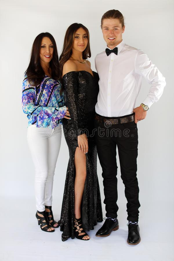 Beautiful woman in back prom dress and handsome guy in suit, teenager ready for a luxury night. royalty free stock photo
