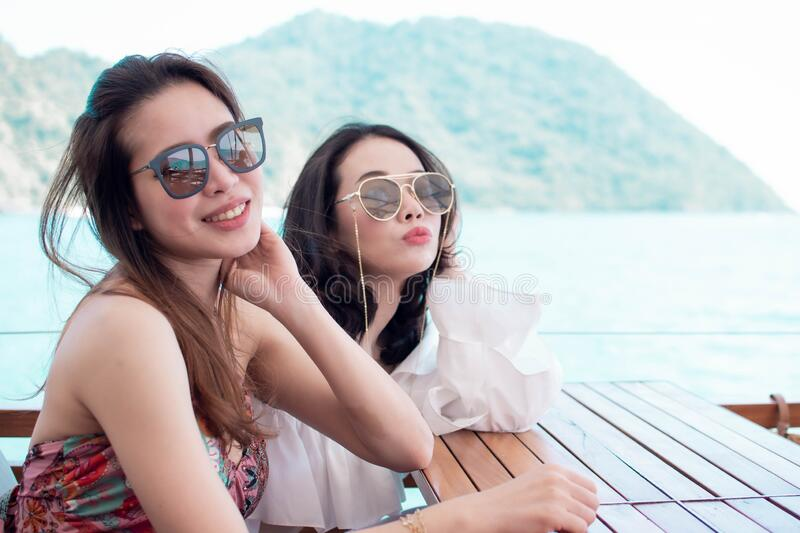 Beautiful women with background of blue sea and mountains stock photo