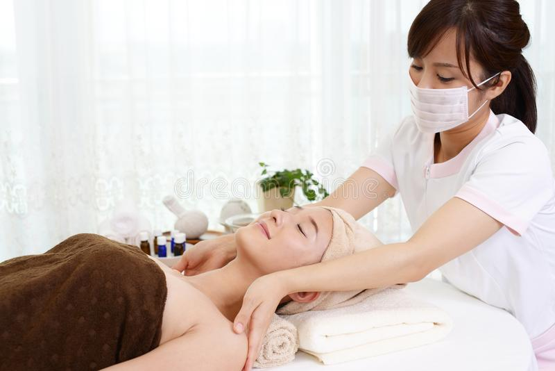 Woman getting a body massage stock images