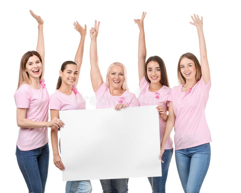 Beautiful women of different ages with pink ribbons holding poster on white background. Breast cancer concept royalty free stock image