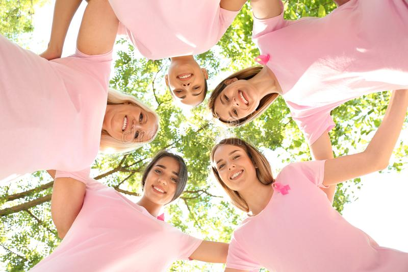 Beautiful women of different ages with pink ribbons outdoors. Breast cancer concept royalty free stock image