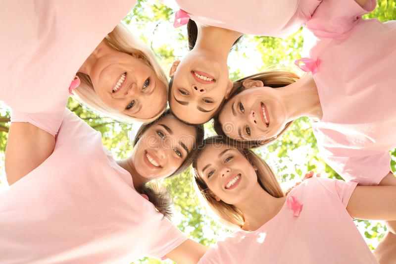 Beautiful women of different ages with pink ribbons outdoors. Breast cancer concept stock photos