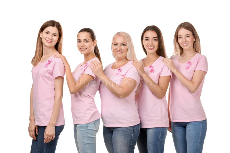 Beautiful women of different ages with pink ribbons on white background. Breast cancer concept royalty free stock photos