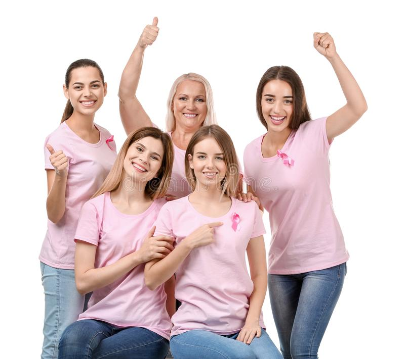 Beautiful women of different ages with pink ribbons on white background. Breast cancer concept stock photos