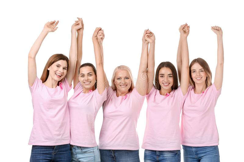Beautiful women of different ages with pink ribbons on white background. Breast cancer concept royalty free stock photography