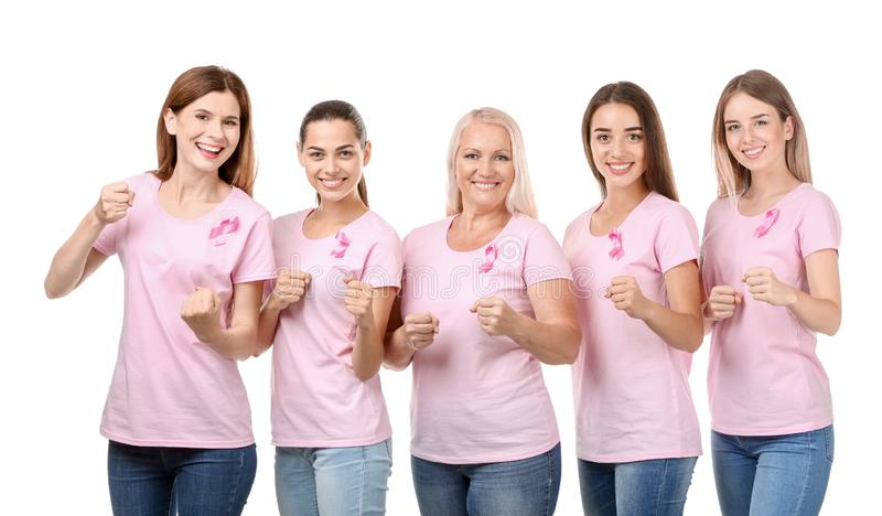 Beautiful women of different ages with pink ribbons on white background. Breast cancer concept royalty free stock images