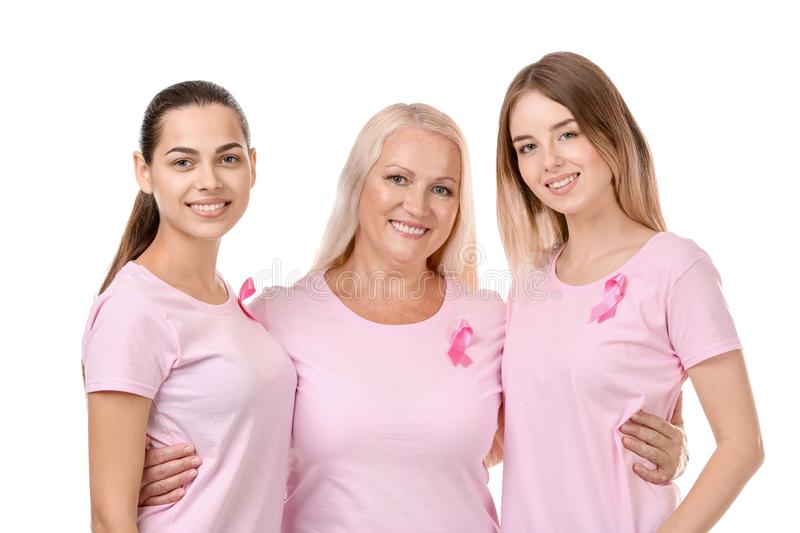 Beautiful women of different ages with pink ribbons on white background. Breast cancer concept royalty free stock image
